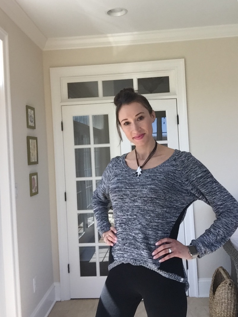 Black Roxy sweater and necklace